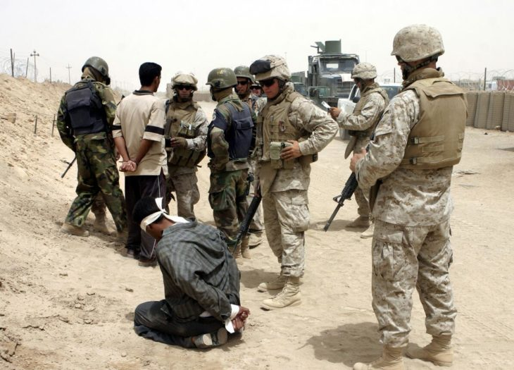 US soldiers arrest Iraqi men in Fallujah, Iraq, 2005