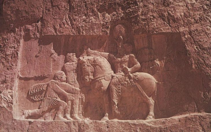 Sasanid relief of the 20th century, near Persepolis. It shows the captured Roman Emperor Valerian, kneeling in front of the Sasanid king Shapur 1.